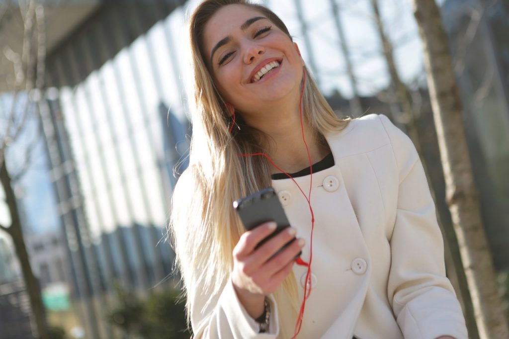 girl on phone laughing