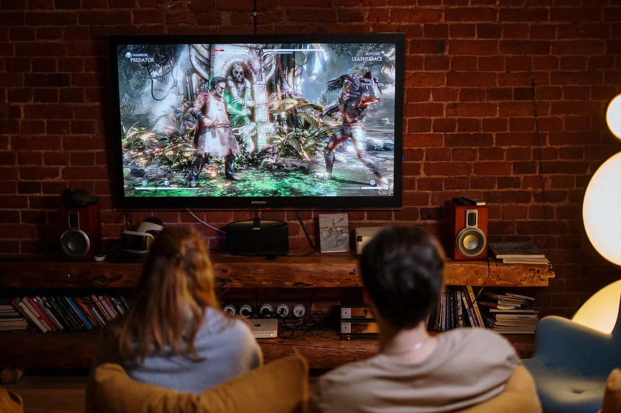 couple playing video game at home