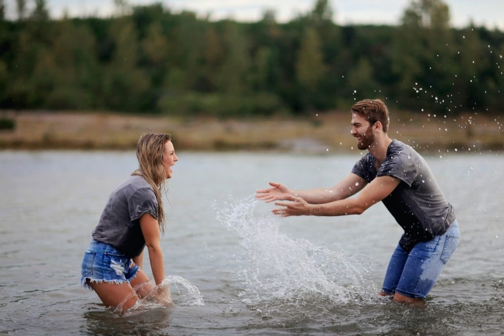 couple splashing water
