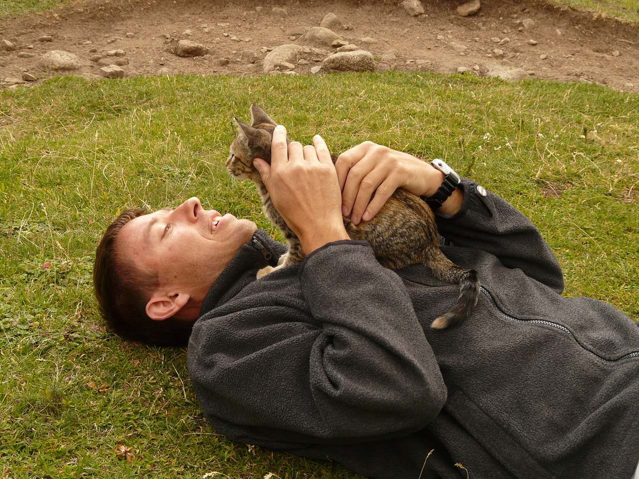 man holding cat outdoors