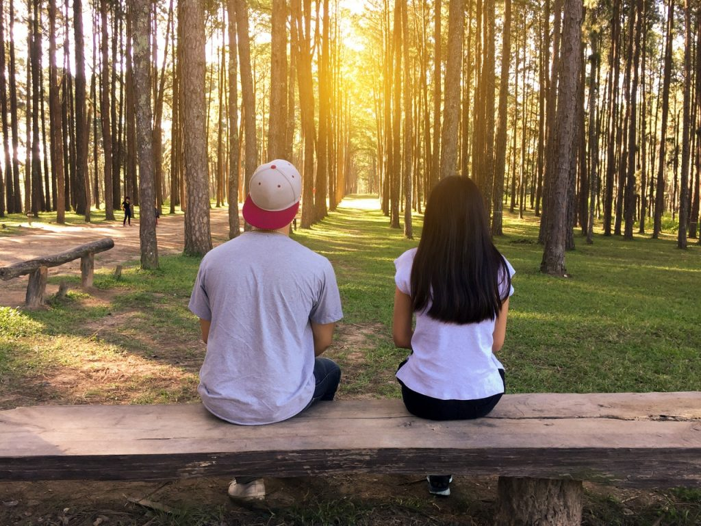 man and woman on bench
