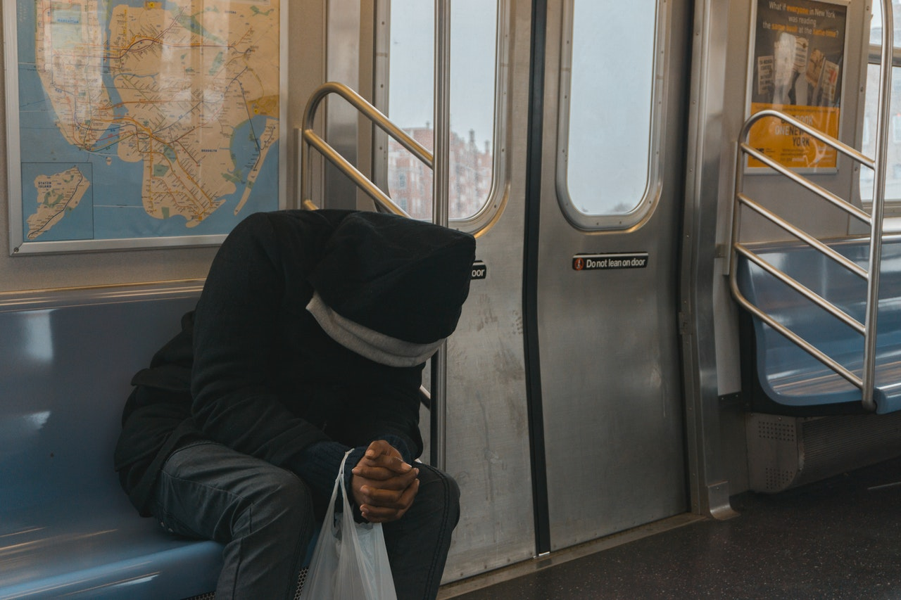 lonely man riding on a train