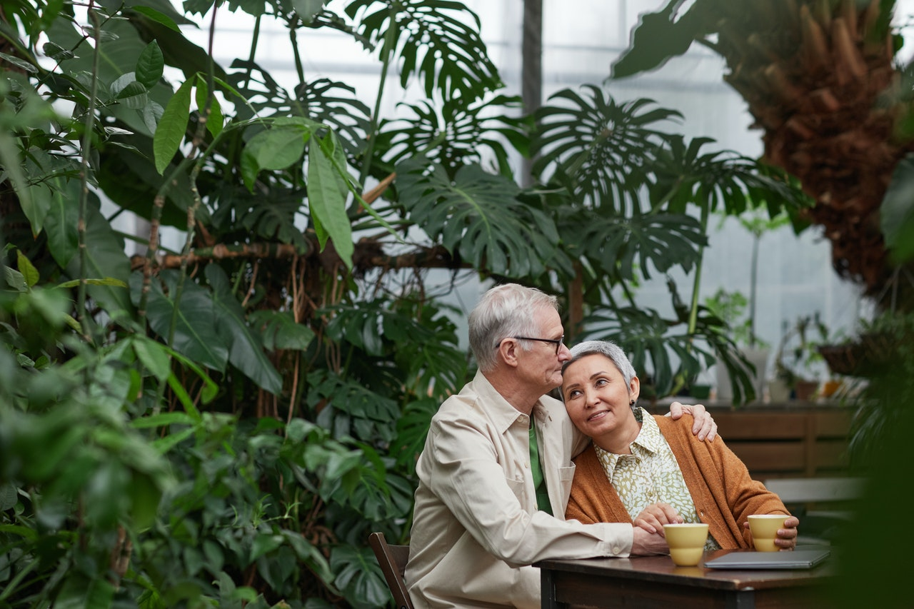 older couple smiling and drinking coffee