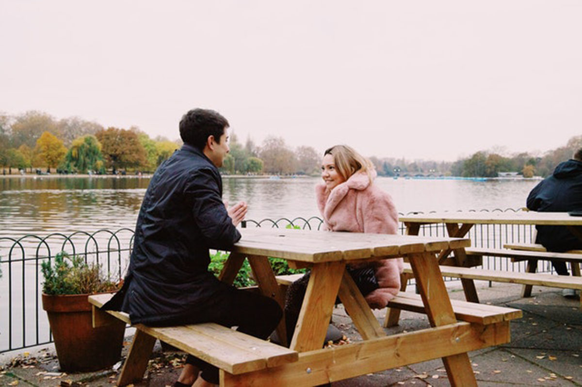 couple talking on a bench outdoors