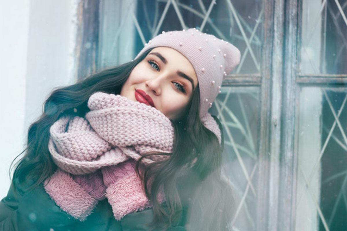 girl in a scarf and hat
