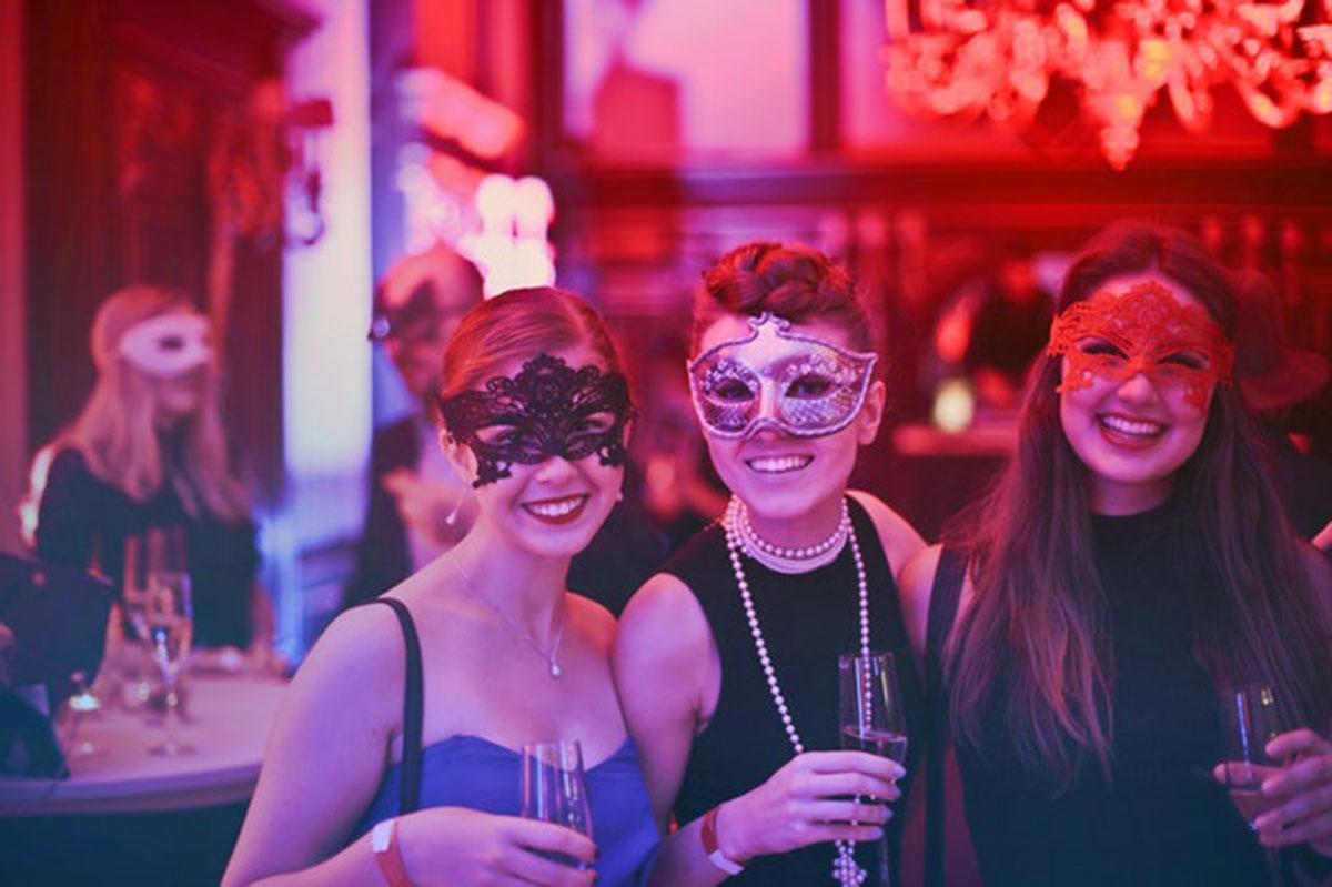 girls at a masquerade party