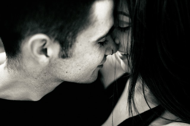 young couple kissing each other