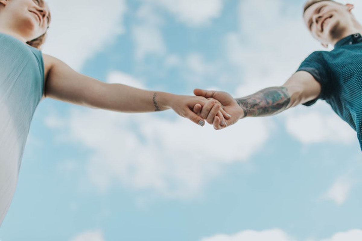 boyfriend and girlfriend holding hands