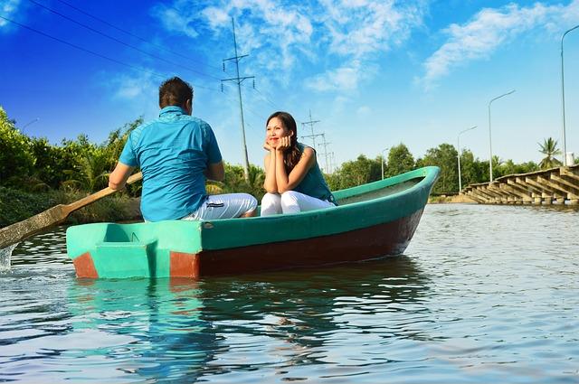 boyfriend and girlfriend in a boat