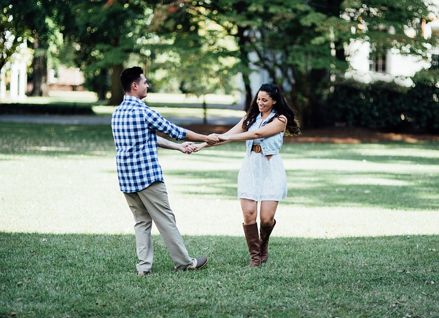 happy boyfriend and girlfriend at the park