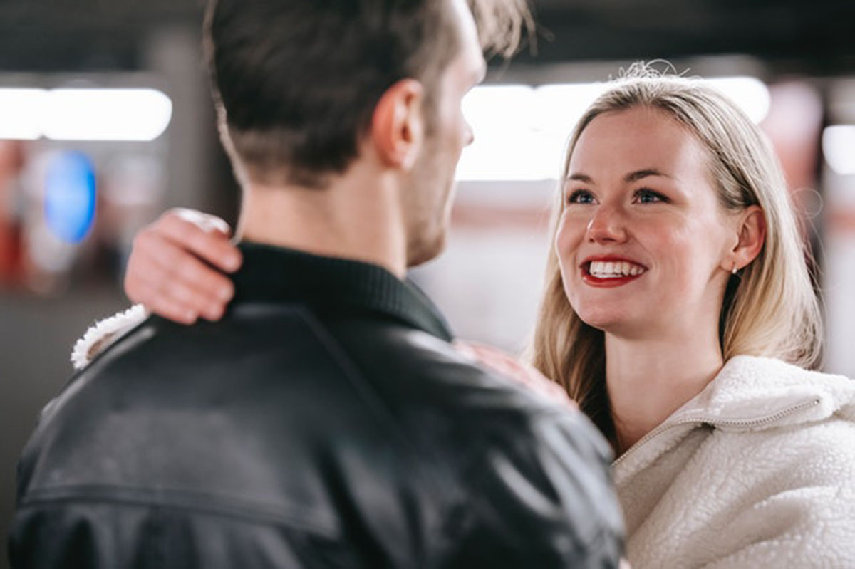 woman smiling at her man