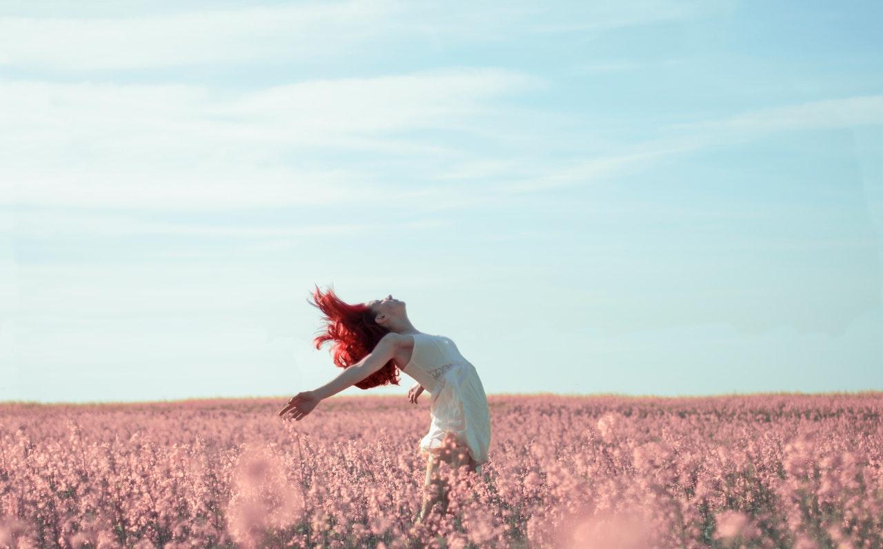 happy single girl in a field